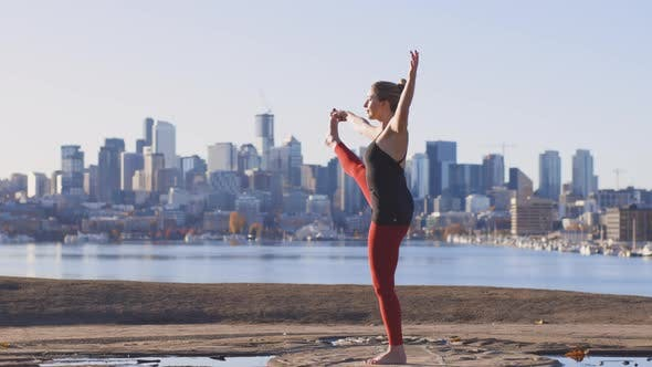 Thumbnail for Extended Hand To Big Toe Pose Girl Yogini Cityscape Background