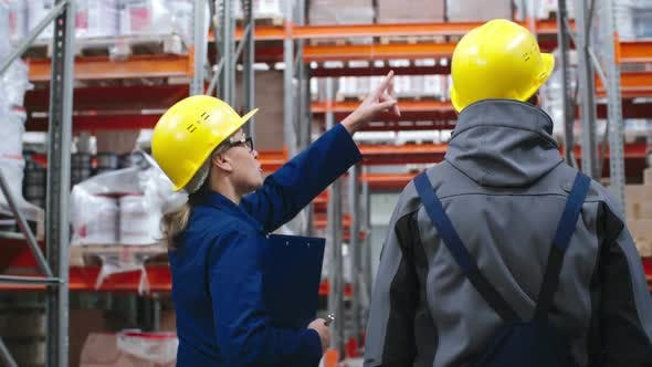 Thumbnail for Warehouse Workers Walking and Discussing Work