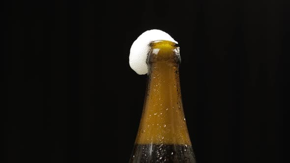 Thumbnail for Opening Cold Bottle of Beer with Bottle Opener. Condensate and Water Drops