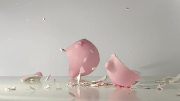 Thumbnail for Pink pig money box falls on a table and breaks on a pieces