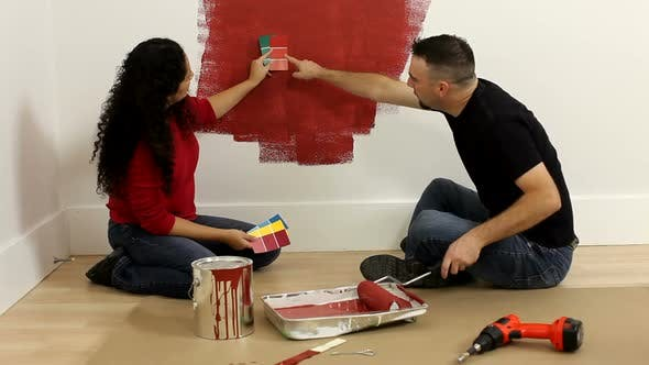Thumbnail for Couple painting room together