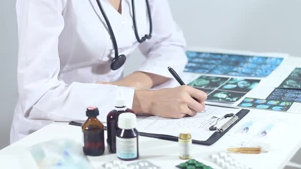 Thumbnail for Woman Doctor Writes Prescription On Medical Forms
