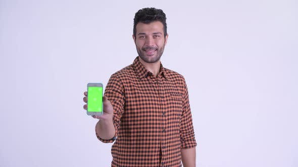 Thumbnail for Happy Bearded Persian Hipster Man Talking and Showing Phone