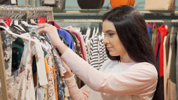 Thumbnail for Woman Looking Shocked By the Price of a Dress at Clothing Store