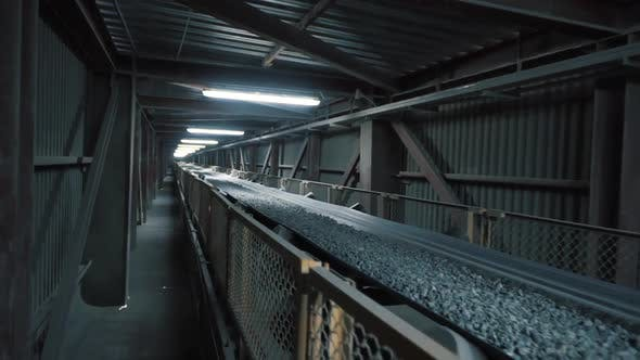 Thumbnail for Close up of rubble moving on the conveyor