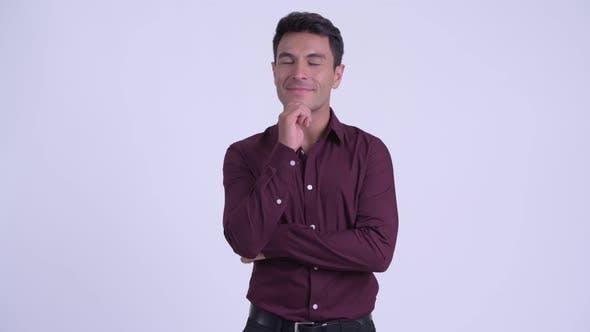Thumbnail for Young Happy Hispanic Businessman Thinking