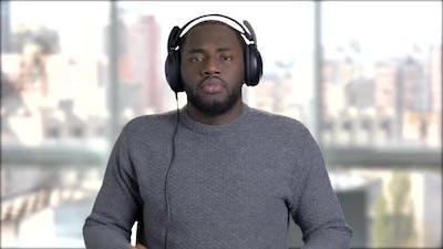 Black Man in Headphones Is Dancing.