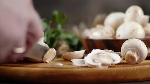 Hands Men Cut the Mushroom Into Pieces