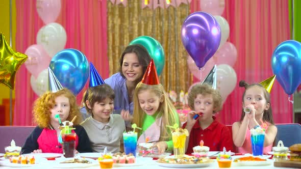Thumbnail for Kids in Colorful Hats Celebrating Birthday with Mother and Fiends