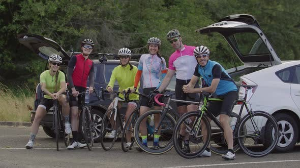 Group of cyclists pose for group photo.  Fully released for commercial use.