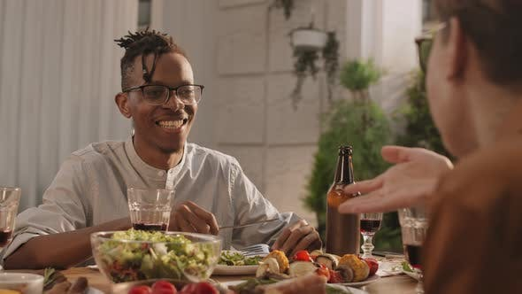 Thumbnail for African Man Having Dinner with Friends