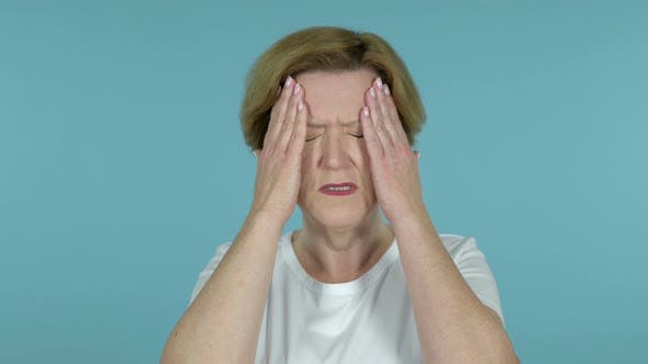 Thumbnail for Old Woman with Headache Isolated on Blue Background