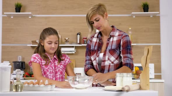 Thumbnail for Mother and Daughter at the Kitchen