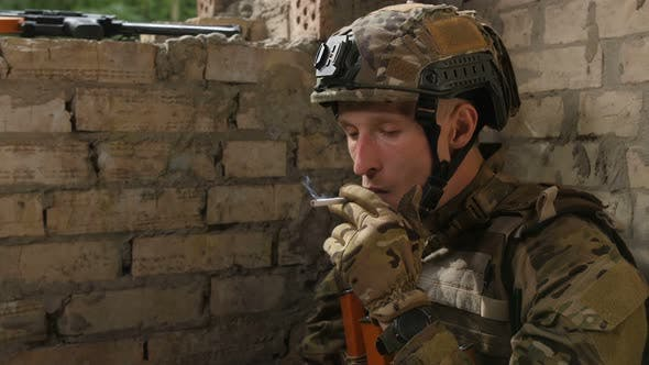 Thumbnail for Tired Army Soldier Relieving Stress with Cigarette