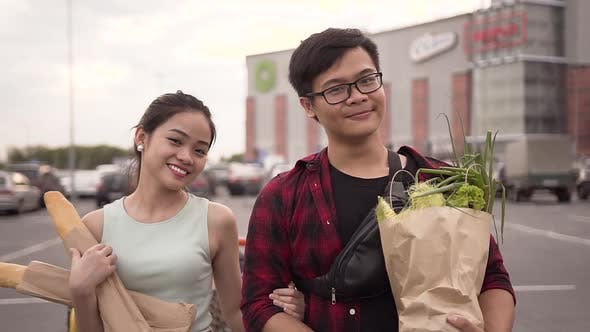 Thumbnail for Smiling Happy Vietnamese People Standing with Food Bags