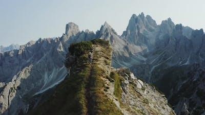 Women Walks on Summit Top Rock