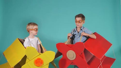 Two Children Visionaries Imagine Flight in Airplane in Sky. Playing Together