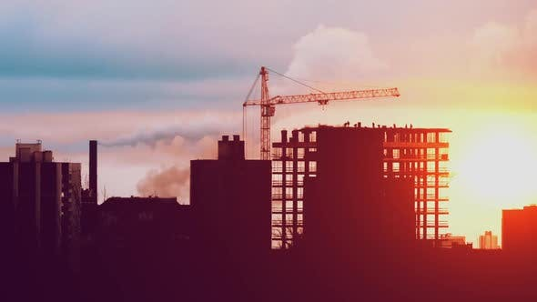 Thumbnail for Tower Crane Working on Construction Residential Building Constructors are Working Sunrise or Sunset