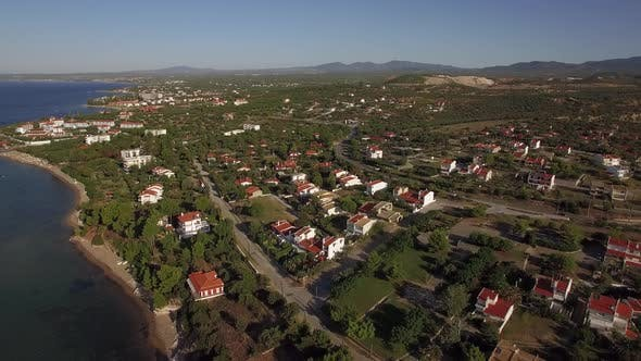 Thumbnail for Aerial View of Green Lands and Houses on Sea Coast. Trikorfo Beach, Greece