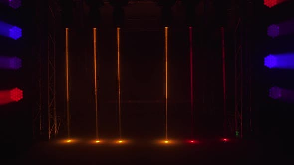Empty Stage with Colorful Bright Spotlights and Hologram Laser Beams