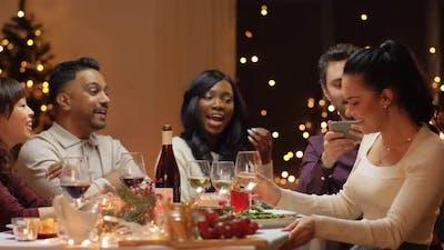 Friends Having Christmas Dinner and Taking Selfie