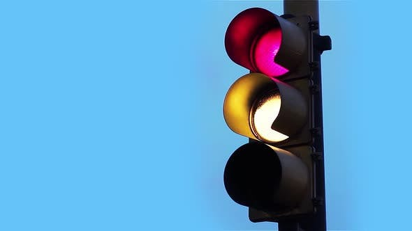 Cover Image for Traffic Light at Sunset.