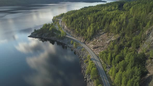 Thumbnail for Flying Over Road with Car and Kroderen Lake Shore in Norway. Aerial Shot. Green Mountain with Trees