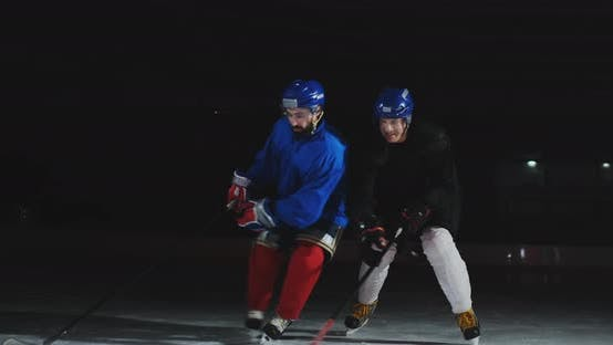 Thumbnail for Two Man Playing Hockey on Ice Rink. Hockey Two Hockey Players Fighting for Puck. STEADICAM SHOT