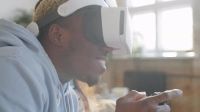 Smiling Black Man in VR Headset Playing Video Game with Wife