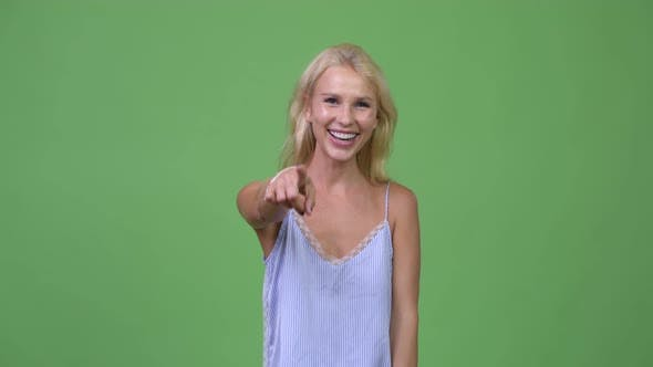Young Happy Beautiful Businesswoman Laughing While Pointing To Camera