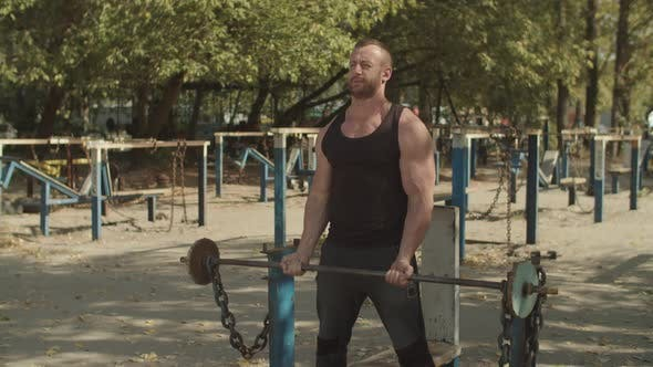 Thumbnail for Athlete Performing Biceps Curls with Barbell