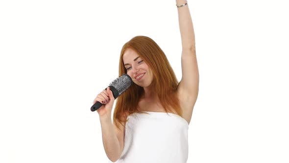 Thumbnail for Young Girl Singing Using a Brush As a Microphone, Slow Motion, Bathroom