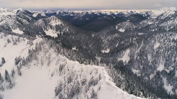 Thumbnail for Snowy Ridge Aerial Of Vast Mountain Range Background