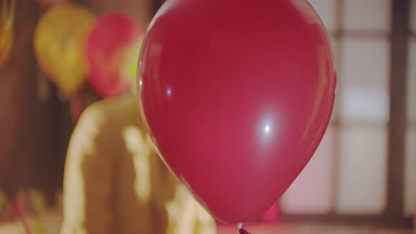 Thumbnail for A Red Balloon Passing By - a Creepy Clown on the Background