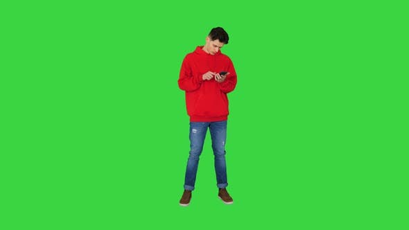 Thumbnail for Successful Young Casual Man Receiving Good News on the Phone and Dancing After This on a Green
