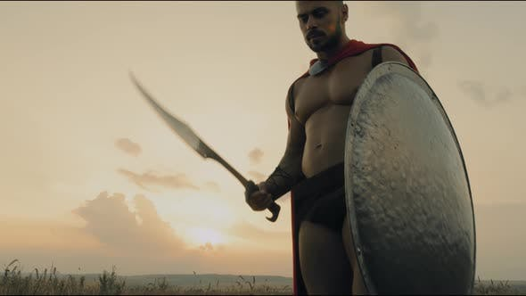 Thumbnail for Shirtless Spartan Posing with Blade Outdoors