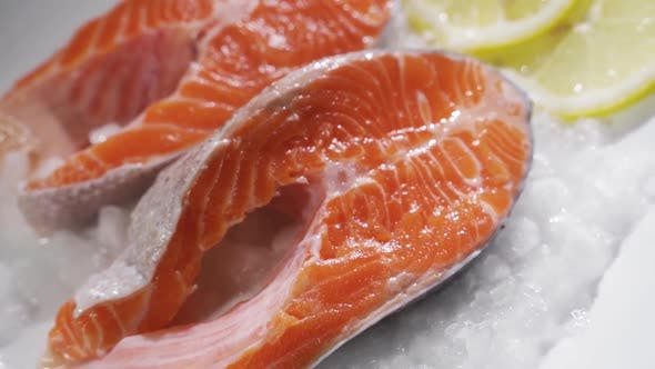 Cover Image for Salmon Steaks and Salmon Fillet. Fresh Salmon Steaks and Fillet Are Laid Out on Ice