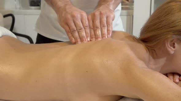 Thumbnail for Sliding Shot of a Woman Receiving Back Massage By Spa Therapist