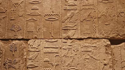 Stone wall with ancient Egyptian hieroglyphs