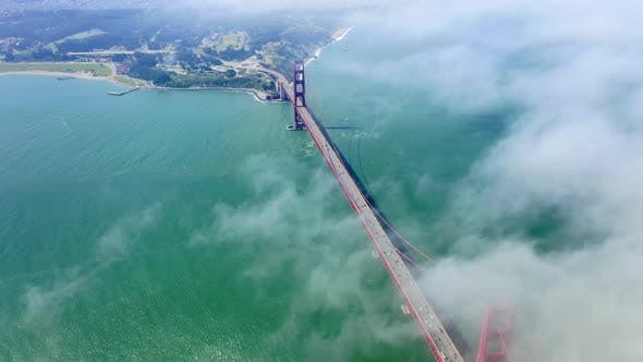 Thumbnail for White Clouds Float the Sky Over the Golden Gate Strait and Famous Golden Gate Bridge. Aerial View