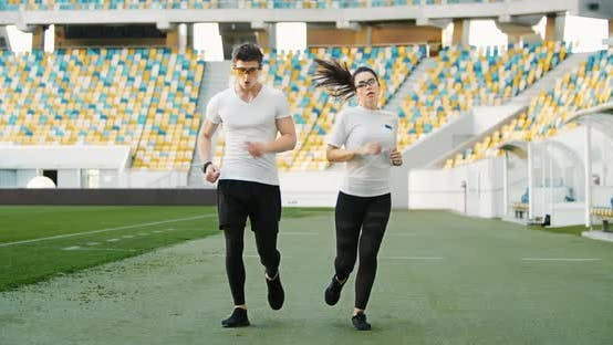 Thumbnail for Athletic Couple Finishing Jogging