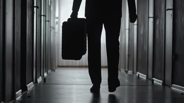Cover Image for Silhouette of Businessman Leaving Hotel