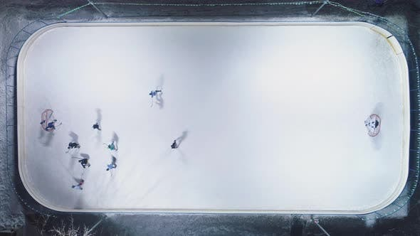 Thumbnail for Playing Ice Hockey on Ice Rink. Aerial Vertical Top-Down View