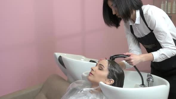 Girl Getting Her Hair Washed