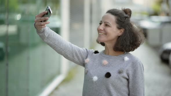 Thumbnail for Attractive Middle Aged Lady Taking Selfie with Smartphone Outdoor