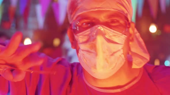 Thumbnail for Close-up Portrait of a Young Man Dressed in the Costume of a Mad Killer Doctor
