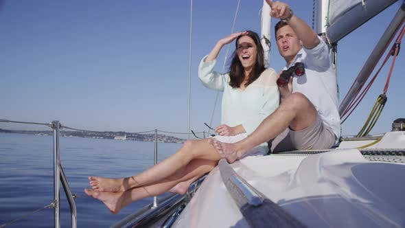 Thumbnail for Young couple on sailboat together looking with binoculars. Shot on RED EPIC for high quality 4K, UHD