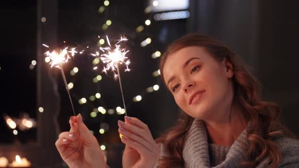 Thumbnail for Happy Young Woman with Sparklers at Home