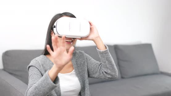 Thumbnail for Woman Watch with Virtual Reality Device at Home