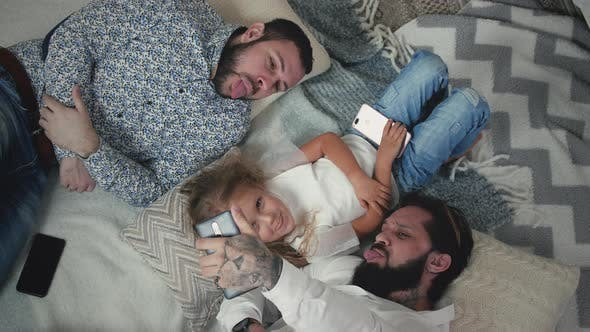 Gay Couple Taking Selfies With Daughter